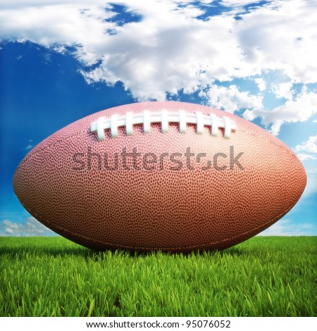 American football on a grass field with a sky background , room for text or copy space