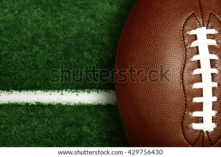 American football on football field background #429756430