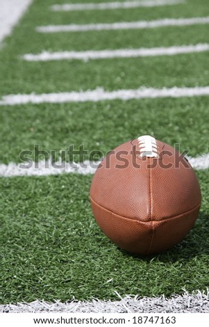 American football on the field - stock photo