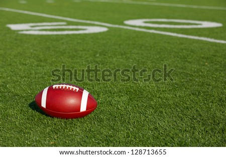 American Football on the Field near the Fifty Yard Line