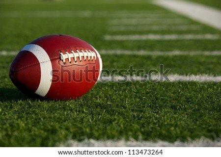 American Football on the Field near the hashmarks or yard lines