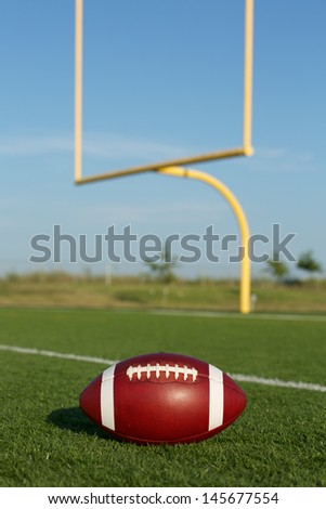 American Football on the Field with Goalposts beyond