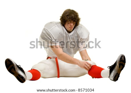 American football player. Adjusting uniform while stretching.