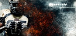 American football player, athlete in helmet on stadium in fire. Sport wallpaper with copyspace on background.