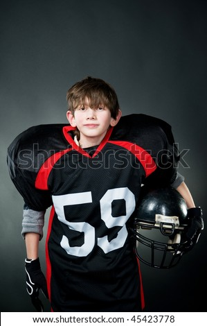 American football player isolated on black