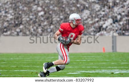American Football Player running upfield