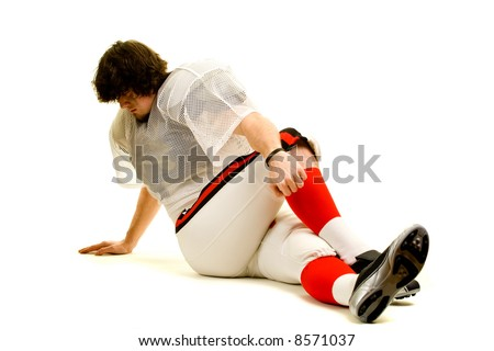 American football player. Stretching before game.