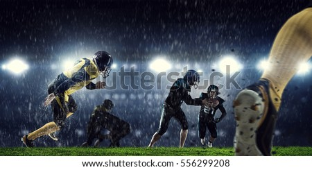 American football players at arena . Mixed media