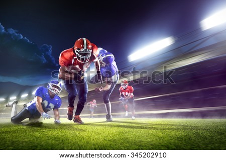 american football players in the action grand arena