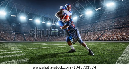 American football players preforms an action play in professional sport stadium #1043981974