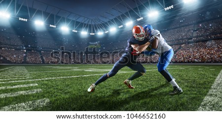 American football players preforms an action play in professional sport stadium
