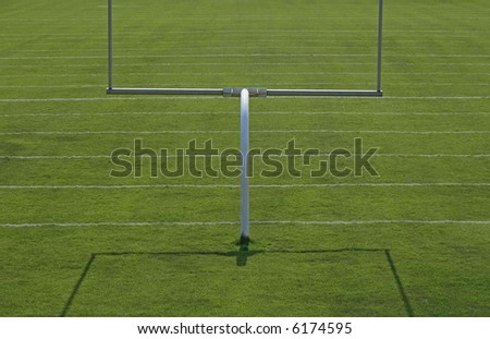 American football playing field with goal posts.