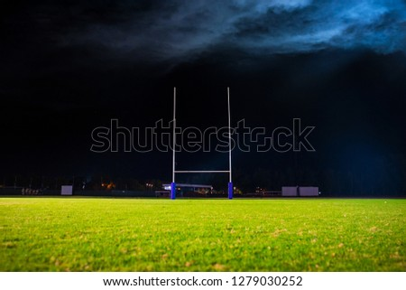 American Football, Rugby goal post. Green grass, night, Dark background, edit space #1279030252
