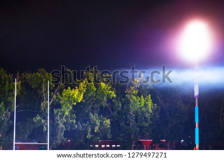 American football, Rugby goal post, lamp light, mist over the stadium. Concept photo, edit space #1279497271