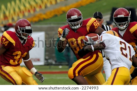 American football Running Back Goes for a touchdown