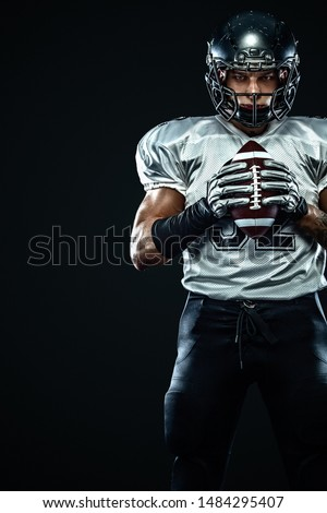 American football sportsman player in helmet on black background. Sport and motivation. Team sports.