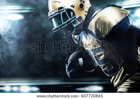 American football sportsman player on stadium running in action