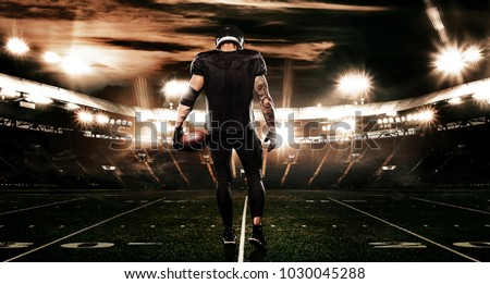 American football sportsman player on stadium. Sports banner and wallpaper with copyspace.