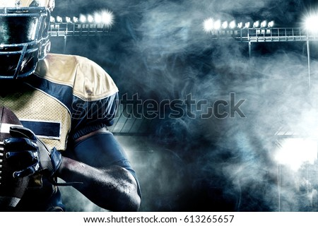 American football sportsman player on stadium with lights on background with copy space #613265657