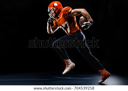 American football sportsman player runing on black background