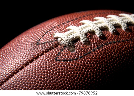 American football, studio shot, black background