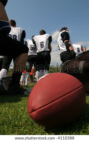 American football team with red eggball