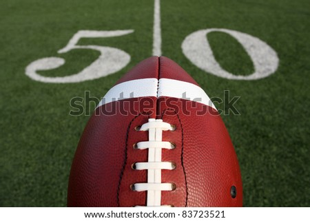 American Football with the Fifty Yard Line Marker Beyond
