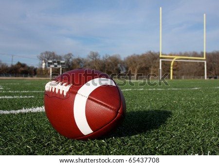 American Football with the goal posts beyond