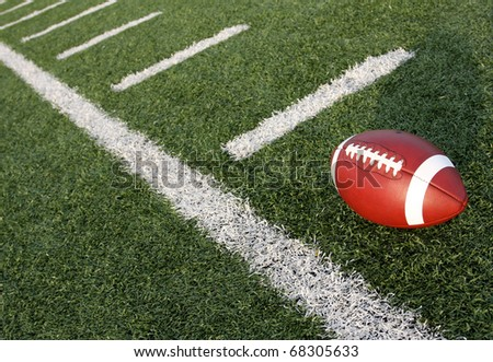 American Football with the yard lines carrying off