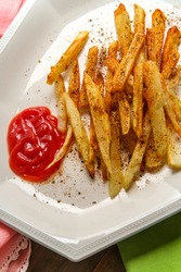 American French fried potatoes with seasoning cut to shoestrings