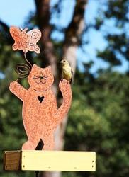 American Gold Finch on Bird Feeder