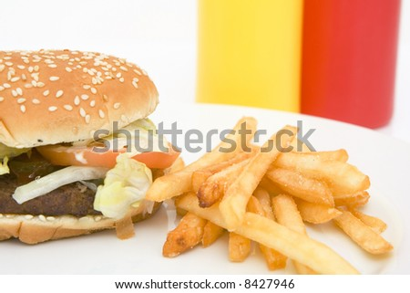 american hamburger with french fries isolated against white background