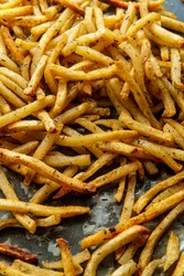 American home-made shoestring French fried potatoes background