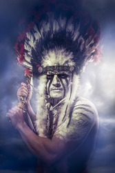 American Indian warrior, chief of the tribe. man with feather headdress and tomahawk, clouds