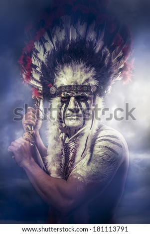 American Indian warrior chief of the tribe man with feather headdress and tomahawk clouds