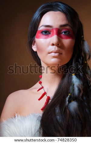 Native American Face Paint Female http://www.shutterstock.com/pic-74828350/stock-photo-american-indian-with-paint-face-camouflage-studio-photo-with-professional-makeup.html