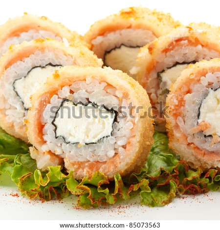 American Maki Sushi - Philadelphia Roll made of Cream Cheese  inside. Deep-Fried Tuna outside. Served on Salad Leaf with Red Pepper