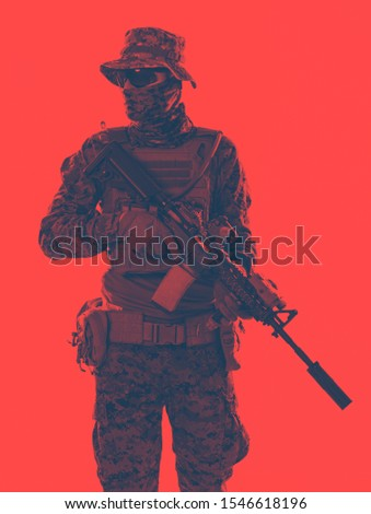american  marine corps special operations soldier with fire arm weapon and protective army tactical gear clothes duo tone effect #1546618196