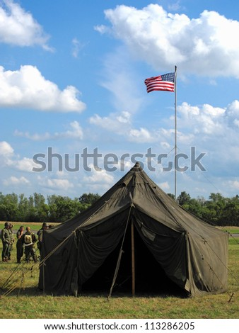 American military camp with flag from second world war era.