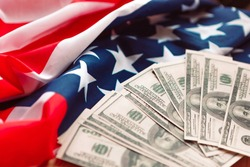 American national flag and dollar bills. Finance concept