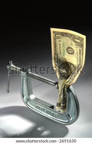 American one US dollar bill squeezed in a clamp isolated on white as metaphor of loosing buying power