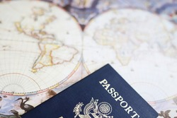 American passport and antique world map, travel image