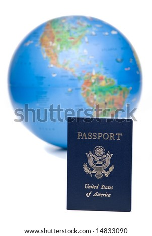 American passport in front of out of focus world globe, over white background