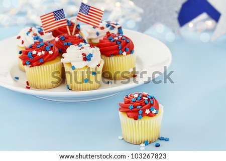 American patriotic themed cupcakes for the Fourth of July. Shallow depth of field with selective focus on cupcake in foreground.