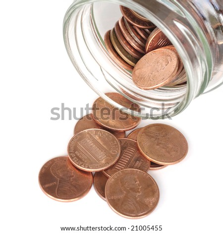 American penny coins coming out of a jar. See more money images in my portfolio.