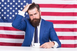 american politician in election. his election campaign. bearded man drink coffee cup. American education reform in july 4. American citizen at USA flag. drinking coffee on tribune