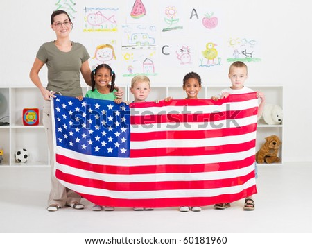 American preschool students and teacher holding a USA flag