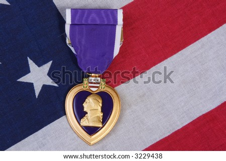 American Purple Heart Medal on a USA red white and blue  Flag Background.