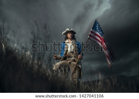 American revolution war soldier with flag of colonies and saber over dramatic landscape. 4 july independence day of USA concept photo composition: soldier and flag. Stock photo ©