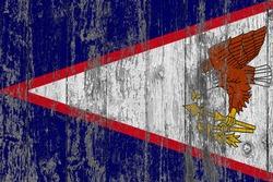 American Samoa flag on grunge scratched wooden surface. National vintage background. Old wooden table scratched flag surface.